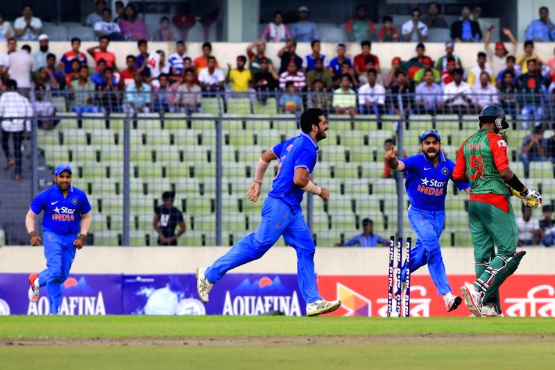 Dhaka (Bangladesh): Indian players celebrate fall of a wicket during the 1st ODI match between India and Bangladesh at Shere Bangla National Stadium in Mirpur, Dhaka, Bangladesh on June 18, 2015.