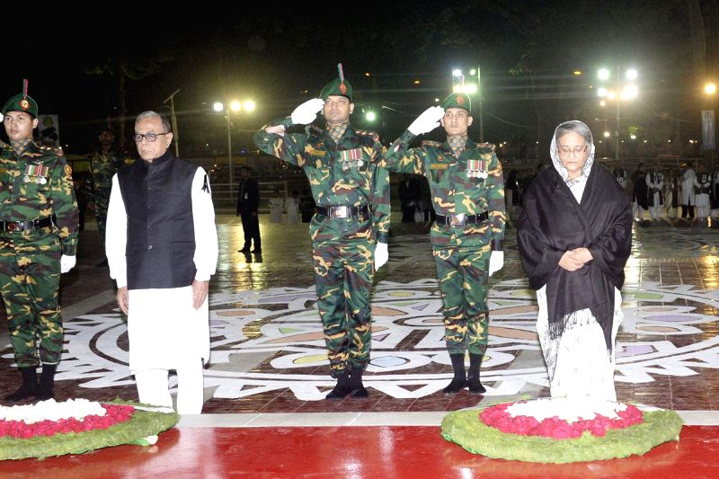 Bangladesh President Md Abdul Hamid and Bangladesh Prime Minister Sheikh Hasina pay tribute at the Central Shaheed Minar in honour of the 1952 Language Movement martyrs in Dhaka, Bangladesh, ... - Sheikh Hasina