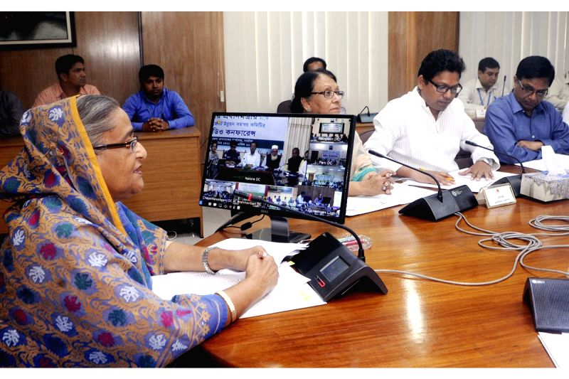 Bangladesh Prime Minister Sheikh Hasina interacts with top officials through video conferencing in Dhaka, Bangladesh on April 13, 2015.