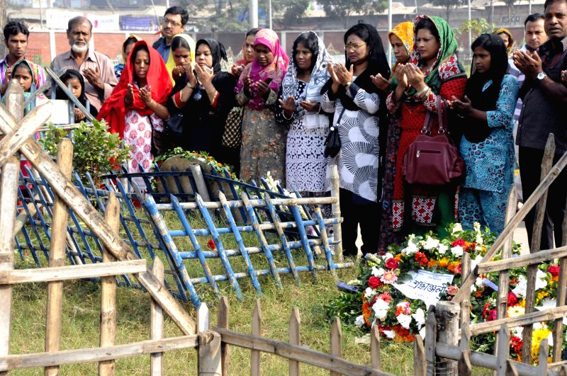 Dhaka (Bangladesh): Relatives of victims who died in a fire accident at the Tazreen garment factory and survivors pray to mark the two-year anniversary of the accident in Dhaka, Bangladesh, Nov. 24, .