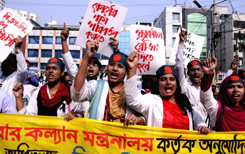 Dhaka (Bangladesh): Students of BSc in Health Technology (Dental) attend a demonstration in front of the National Press Club in Dhaka, capital of Bangladesh, on Dec. 7, 2014. Around 300 students ...