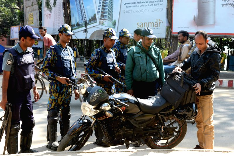 Bangladeshi policemen check motorcyclists on a street during a 72-hour countrywide non-stop strike called by Bangladesh Nationalist Party (BNP) in Dhaka, Bangladesh, Feb. 2, 2015. Former ... - Khaleda Z