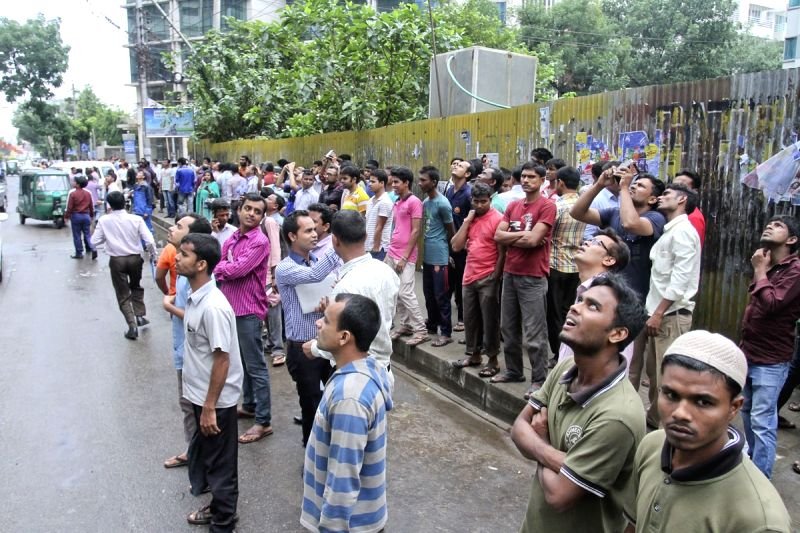 Curious onlookers gather in front of `Mohammad Tower` in Dhaka of Bangladesh on April 25, 2015. The US Geological Survey said the epicentre of the earthquake was at Lamjung in Nepal - a ...
