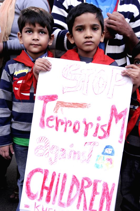 Bangladeshi children attend a protest against the Taliban attack on an army-run school in Pakistan, in Dhaka, Bangladesh, Dec. 21, 2014. At least 141 people, ...