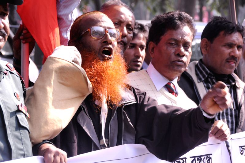 Bangladeshi activists shout slogans during a protest rally to demand capital punishment ahead of the verdict announcement in Dhaka, Bangladesh, Dec. 23, 2014. ... - Syed Mohammed Kaiser