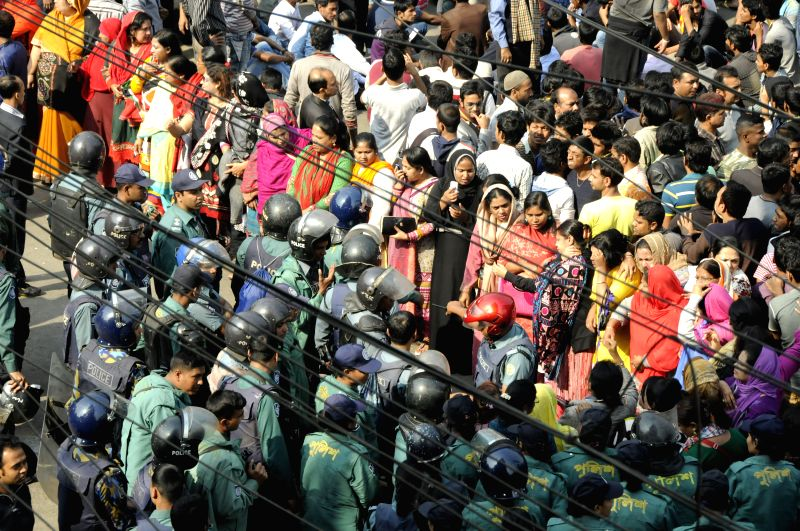 Supporters of Bangladesh Nationalist Party (BNP) protest outside a court as Bangladesh ex-Prime minister Khaleda Zia appears for hearing in two graft cases in Dhaka, . - Khaleda Zia