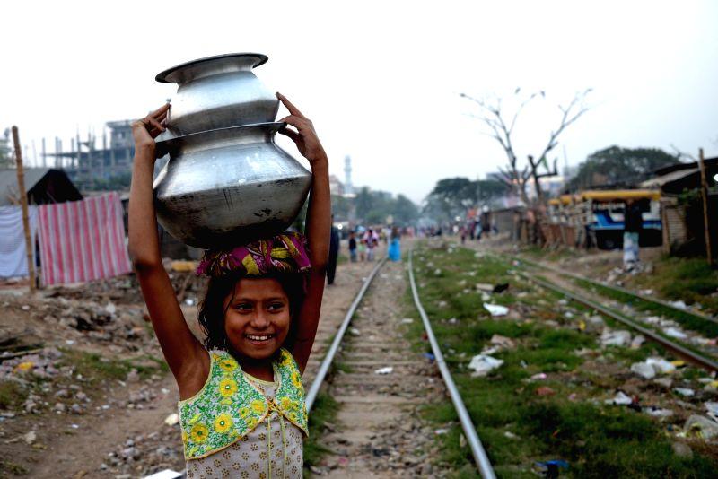 DHAKA, Dec. 24, 2018 (Xinhua) -- A girl walks on the rail lines in Dhaka, capital of Bangladesh, on Dec. 23, 2018. (Xinhua/IANS)