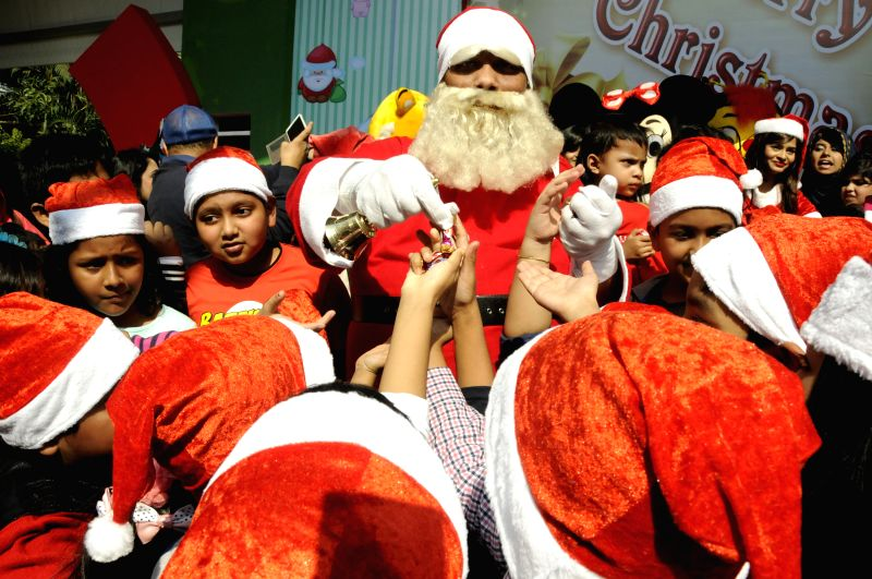 Children celebrate Christmas during the Christmas celebration at the Sonargaon Hotel in Dhaka, Bangladesh, Dec. 25, 2014.