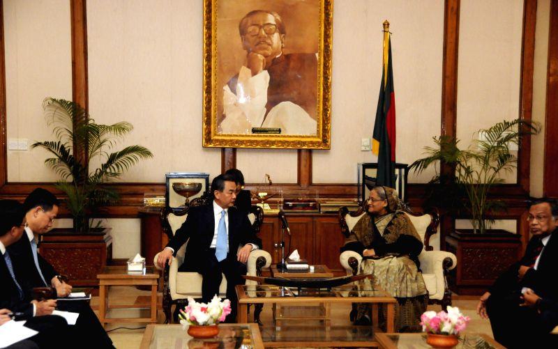 Chinese Foreign Minister Wang Yi (L center) meets with Bangladeshi Prime Minister Sheikh Hasina (R center) in Dhaka, Bangladesh, Dec. 28, 2014. (Xinhua/Shariful ... - Wang Y and Hasina
