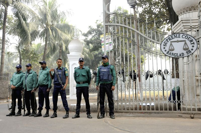 Bangladeshi policemen stand guard in front of the Supreme Court during a verdict announcement in Dhaka, capital of Bangladesh, on Dec. 30, 2014. Bangladesh's war ...