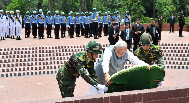 Dhaka: Prime Minister Narendra Modi lays wreath to the martyrs, at National Martyrs' Memorial, in Savar, Dhaka on June 6, 2015. - Narendra Modi