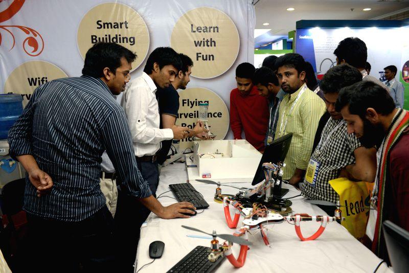 Bangladeshi people visit the Digital World Exhibition in Dhaka, Bangladesh, Feb. 10, 2015. The Digital World Exhibition lasts from Feb. 9 to Feb. 12. (Xinhua/Shariful