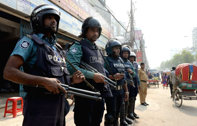 Bangladeshi policemen stand guard on a street during a 72-hour countrywide non-stop strike called by Bangladesh Nationalist Party (BNP) in Dhaka, Bangladesh, Feb. 8, .. - Khaleda Z