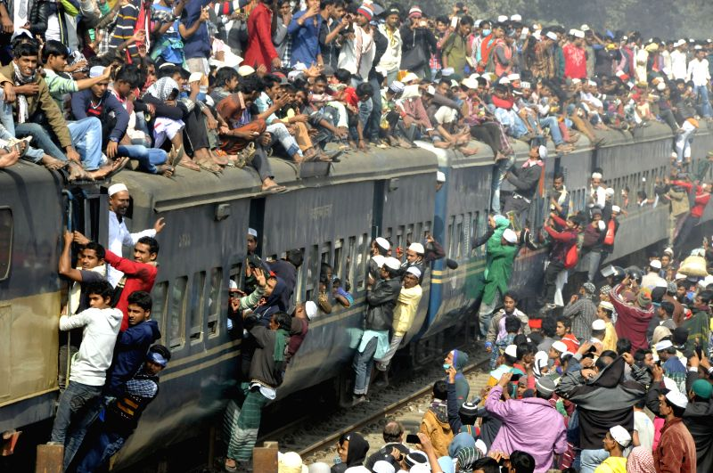 Commuters ride on the roof of a train as they attend the final prayer ceremony on the bank of Turag River on the outskirts of Dhaka, Bangladesh, Jan. 11, 2015. The ...