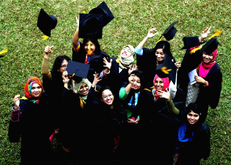 Graduated students celebrate during the 49th convocation day of Dhaka University in Dhaka, Bangladesh, Jan. 13, 2015. A total of 6,157 graduates of medical, arts, ...