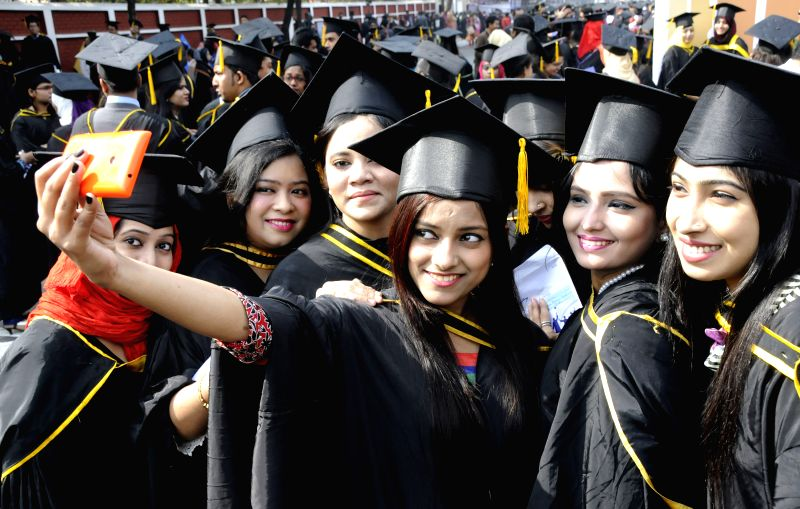 Graduated students pose for photos during the 49th convocation day of Dhaka University in Dhaka, Bangladesh, Jan. 13, 2015. A total of 6,157 graduates of medical, ...