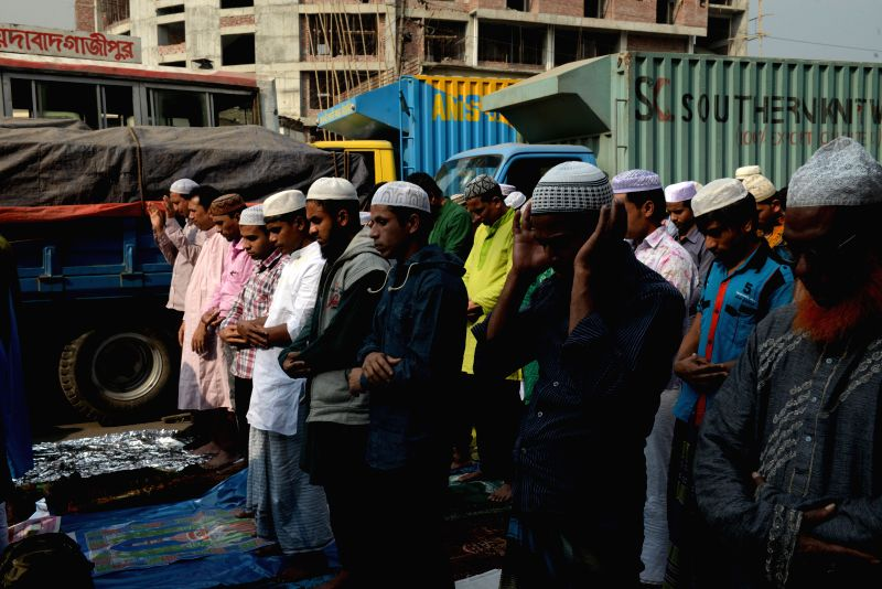 A horde of Muslim devotees flocks to the bank of Turag River on the first day of the second phase of Muslim congregation Biswa Ijtema on the outskirts of Dhaka, ...