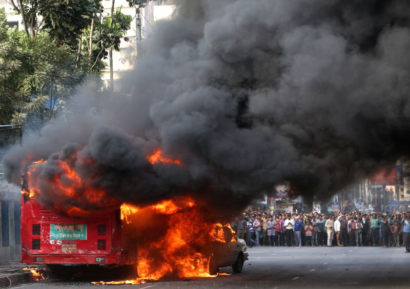 A bus is set on fire during the nonstop block called by Bangladesh Nationalist Party (BNP) in Dhaka, Bangladesh, Jan. 6, 2015. Bangladesh's anti-government protesters .