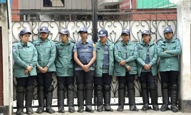 Policemen stand guard in front of ex-Prime Minister Khaleda Zia's office during the non-stop block called by Bangladesh Nationalist Party (BNP) in Dhaka, Bangladesh, .. - Khaleda Z