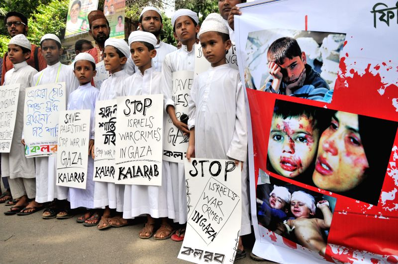 Bangladeshi Muslims attend a protest against Israeli offensive on the Gaza Strip in front of National Press Club in Dhaka, Bangladesh, July 12, 2014. The death toll ..