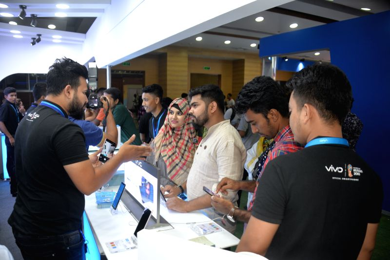 DHAKA, July 12, 2018 - Visitors see latest communication gadgets at a booth during a Smartphone & Tab Expo in Dhaka, the capital city of Bangladesh, on July 12, 2018.