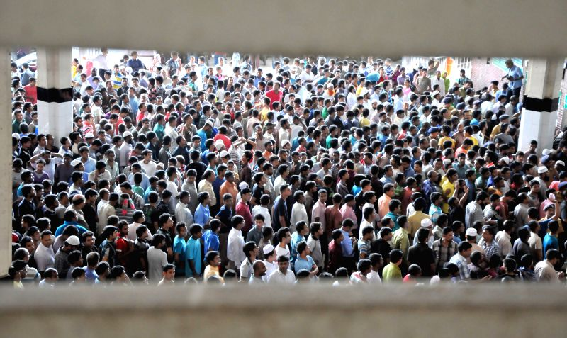 Bangladeshi home-bound passengers stand in long queues to buy advance tickets ahead of Eid-ul-Fitr festival at Kamalapur Railway Station in Dhaka, Bangladesh, July ...
