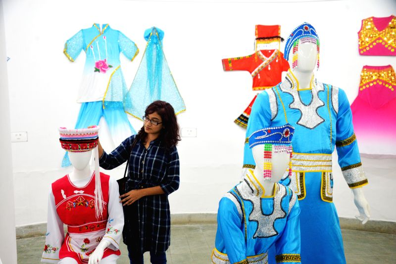 DHAKA, July 22,  2018 - A visitor touches the costume at the exhibition portraying the history and culture of the ancient Silk Road in Zainul Gallery of the Faculty of Fine Arts of Dhaka University ...