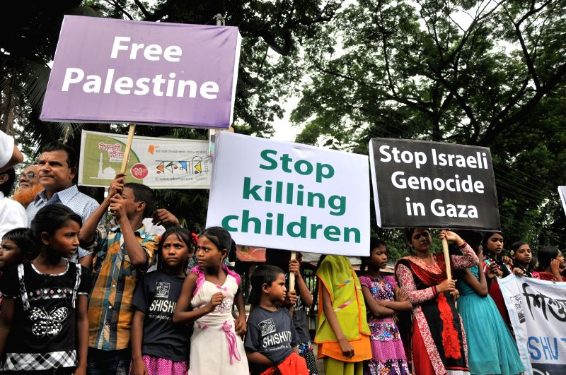 Bangladeshi children hold placards during a protest against ongoing Israeli air raids on the Gaza Strip in Dhaka, Bangladesh, July 24, 2014. Israeli offensive in the .