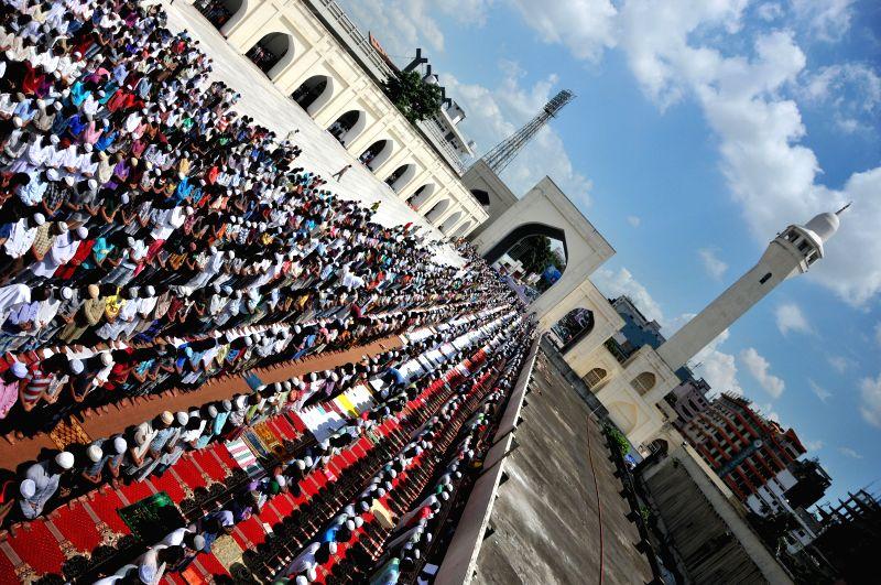Bangladeshi Muslims attend the last Friday noon prayer of the Islamic holy month of Ramadan at the National Mosque Baitul Mukarram in Dhaka, Bangladesh, July 25, ...