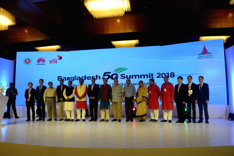DHAKA, July 25, 2018 - Officials and guests pose for a group photo at the Bangladesh 5G Summit 2018 in Dhaka, Bangladesh, on July 25, 2018. Chinese telecommunications giant Huawei conducted ...