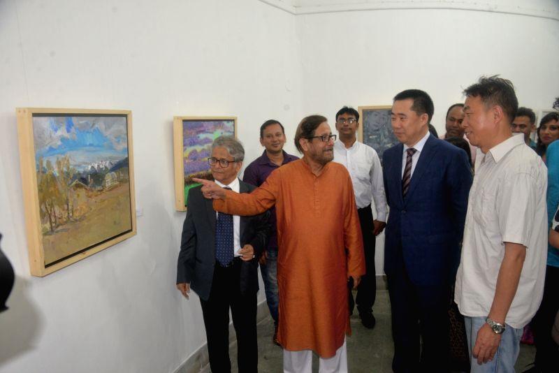 """DHAKA, July 27, 2018 - Bangladeshi Cultural Affairs Minister Asaduzzaman Noor (3rd L) and Chinese Ambassador to Bangladesh Zhang Zuo (5th L) visit the """"Silk Road"""" exhibition in Dhaka, ... - Asaduzzaman Noor"""