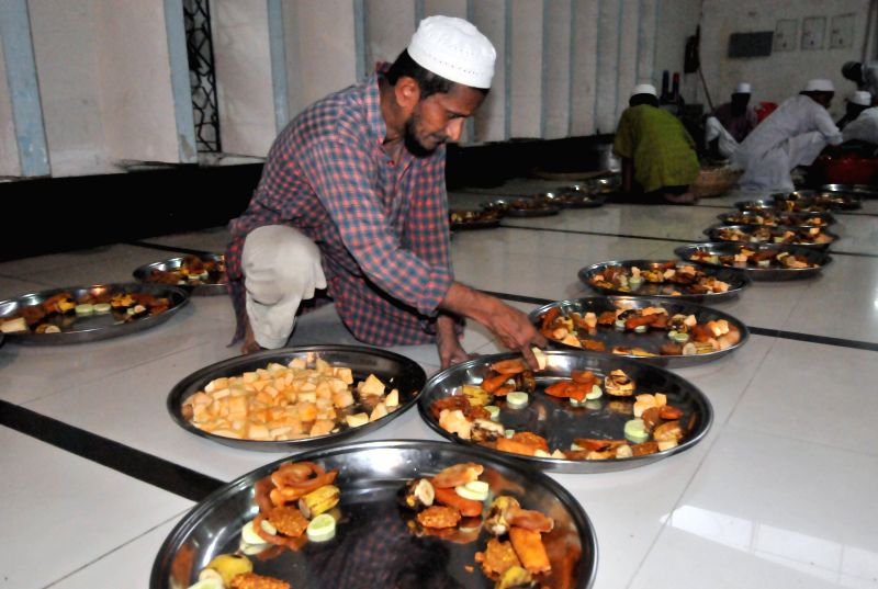 A Bangladeshi Muslim arranges food for breaking the daytime fast during Islamic holy month of Ramadan at the National Mosque Baitul Mukarram in Dhaka, Bangladesh, July