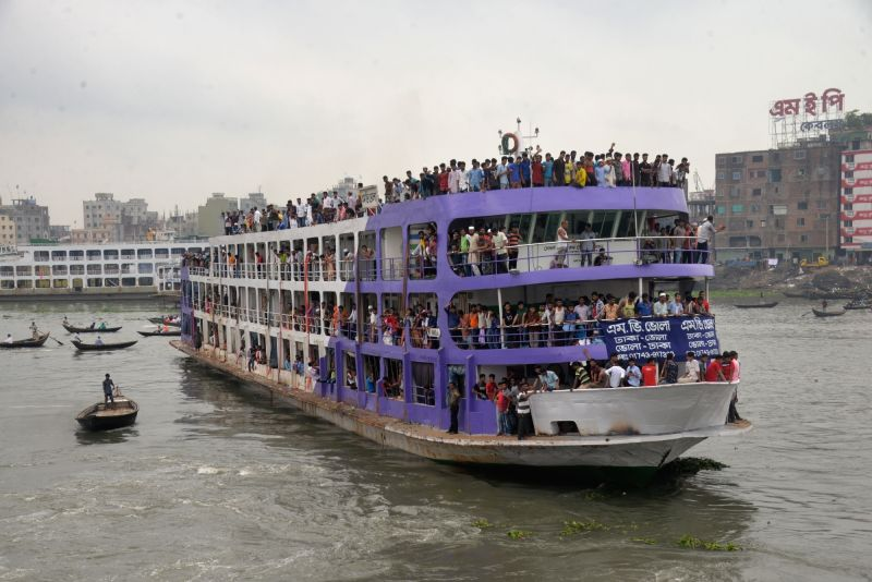 DHAKA, June 13, 2018 - A ferry packed with travelers leaves the Sadarghat Launch Terminal in Dhaka, capital of Bangladesh, on June 13, 2018. A lot of people went to the launch terminal in Dhaka on ...