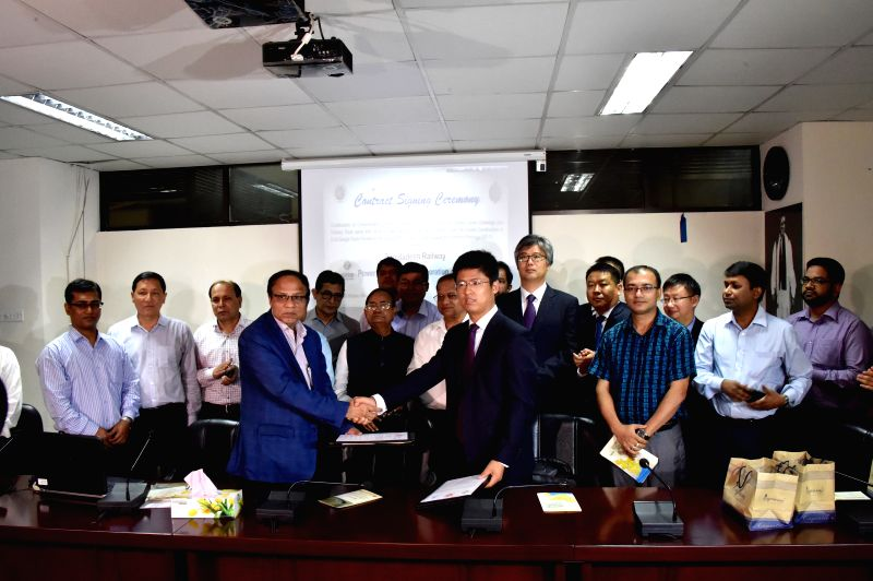 DHAKA, June 19, 2017 - Commercial Manager of Power Construction Corporation of China Limited Zhang Peiliang and Additional Director General (infrastructure) of Bangladesh Railway Kazi Mohammad ...