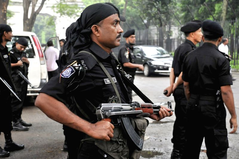 Members of the anti-crime elite force Rapid Action Battalion (RAB) stand guard during a verdict announcement in front of the Supreme Court in Dhaka, Bangladesh, June .