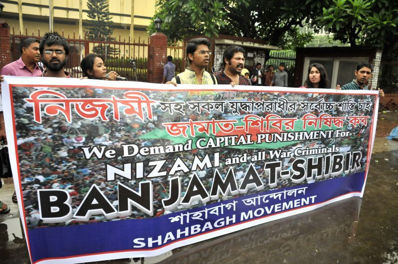 Social activists demand capital punishment for all war criminals during a verdict announcement in front of the Supreme Court in Dhaka, Bangladesh, June 24, 2014. A ...