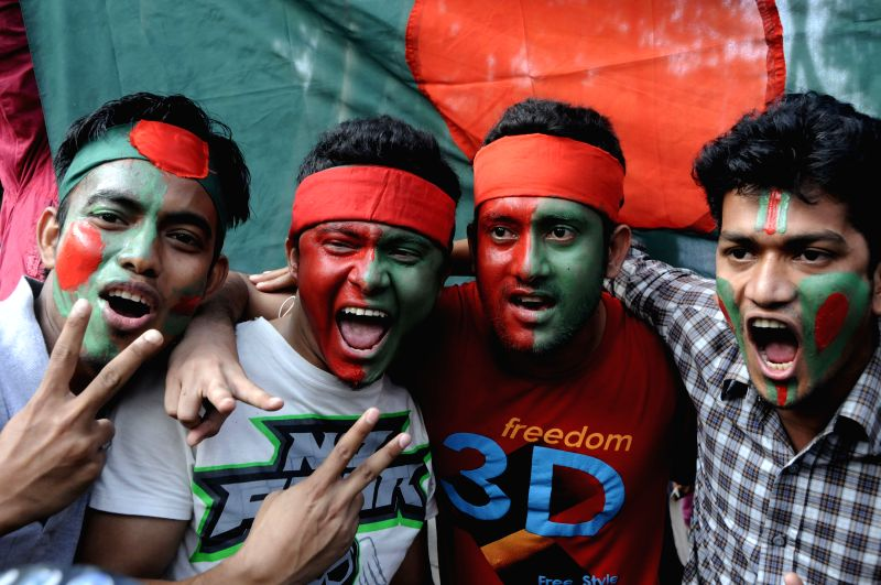 Bangladeshi cricket fans cheer to offer their wishes to Bangladesh cricket team ahead of the International Cricket Council (ICC) World Cup quarter-finals against ...
