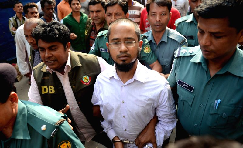 Farabi Shafiur Rahman (C, front), the prime suspect in a murder case of writer blogger Avijit Roy, arrives to a court for appeal in Dhaka, Bangladesh, March 3, 2015. ... - Avijit Roy