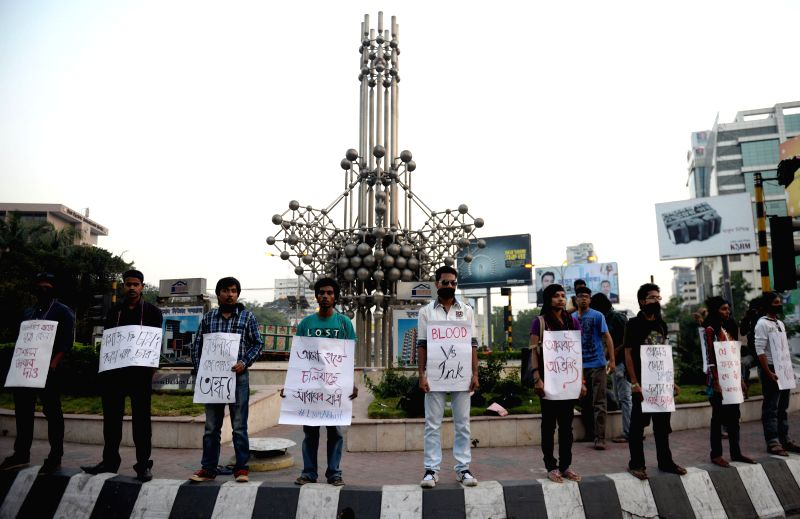Social activists and bloggers attend a protest demanding punishment of the killer in a murder case of writer blogger Avijit Roy in Dhaka, Bangladesh, March 3, 2015. ... - Avijit Roy