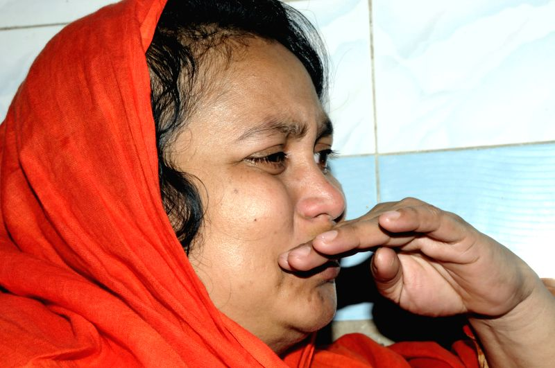 A relative of blogger Wshiqur Rahman cries at Dhaka Medical College in Dhaka, Bangladesh, March 30, 2015. A blogger was hacked to death by machete-wielding ...