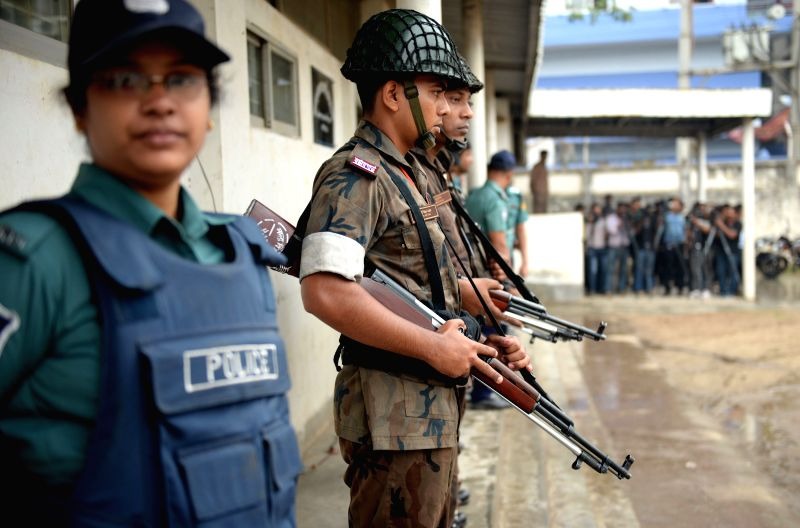 Border Guard Bangladesh (BGB) personnel stand guard at a special court during a trial against Bangladesh's former Prime Minister and Bangladesh Nationalist Party ...