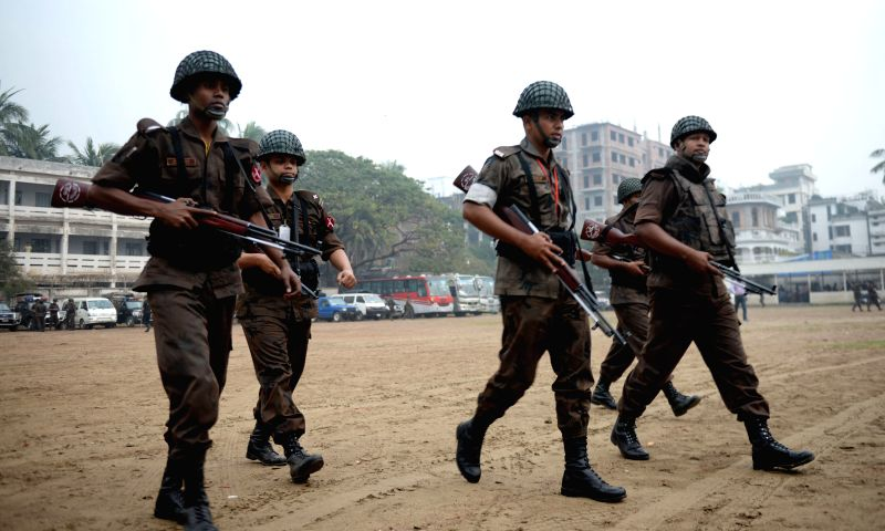 Border Guard Bangladesh (BGB) personnel arrive at a special court during a trial against Bangladesh's former Prime Minister and Bangladesh Nationalist Party (BNP) ...