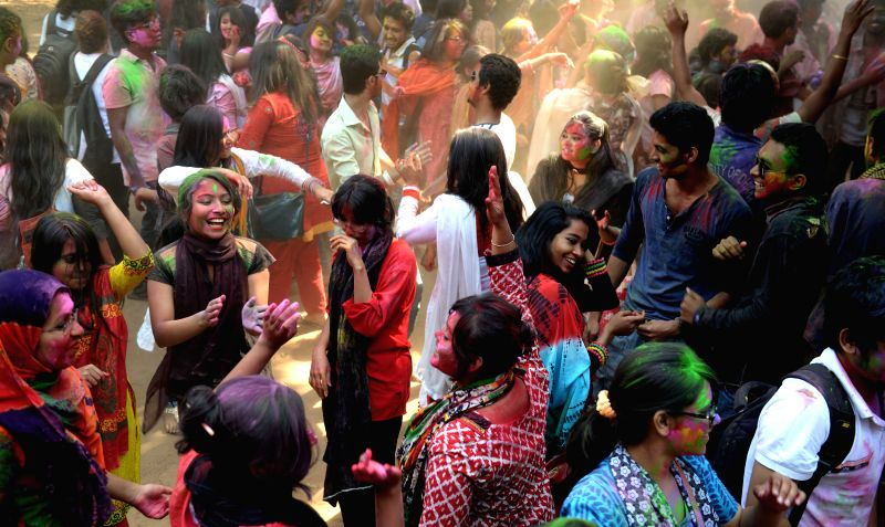 Students of Dhaka University dance with colored powders to celebrate the Holi festival in Dhaka, Bangladesh, March 8, 2015. The Holi festival is a carnival of colors, ...