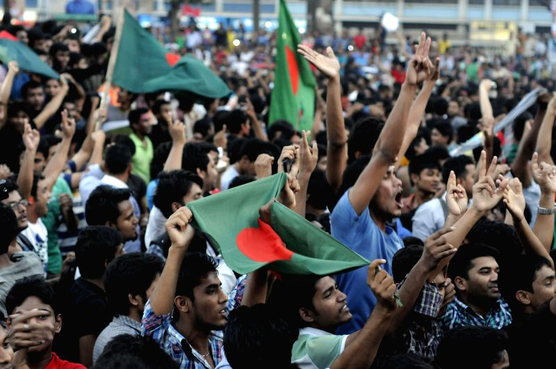 Bangladesh cricket fans cheer after the national team defeated England in the International Cricket Council (ICC) World Cup game in Dhaka, Bangladesh, March 9, 2015. ...