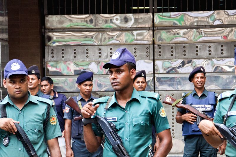 DHAKA, May 10, 2016 - Bangladeshi policemen stand guard in front of the gate of the Central Jail in Dhaka, Bangladesh, May 10, 2016. Authorities in Bangladesh have heightened security in capital ...