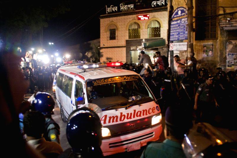 DHAKA, May 11, 2016 - People surround an ambulance carrying the body of Bangladesh Jamaat-e-Islami party's Ameer (president) Motiur Rahman Nizami at the Dhaka Central Jail in Dhaka, Bangladesh, May ...