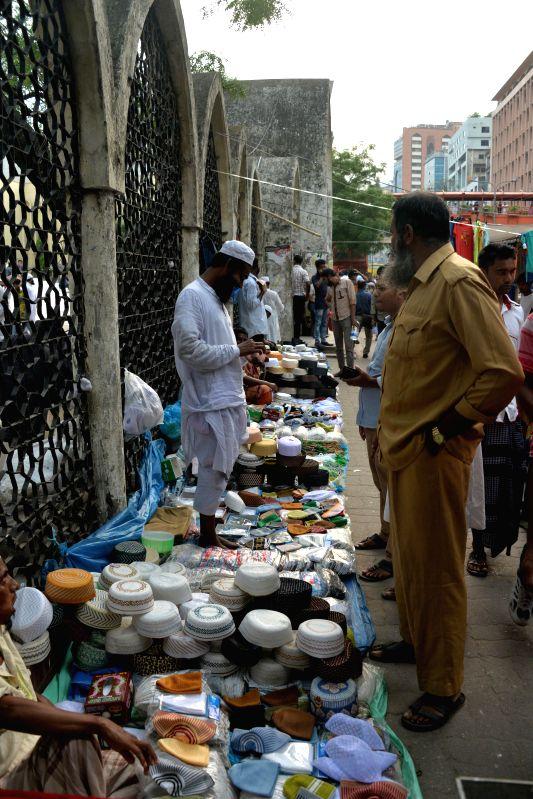 DHAKA, May 11, 2017 - Vendors sell prayer caps in a street near the Baitul Mukarram National Mosque ahead of Shab e-Barat, the night of forgiveness, in Dhaka, capital of Bangladesh on May 11, 2017.