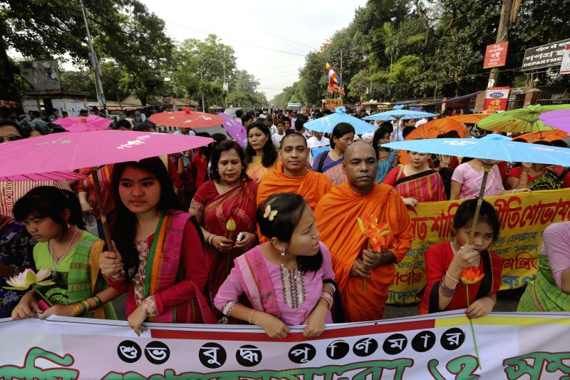 Bangladeshi Buddhist devotees take part in a rally during the Buddha Purnima festival in Dhaka, Bangladesh, May 13, 2014. Buddha Purnima, which marks the birth, ...