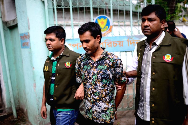 DHAKA, May 15, 2016 - Bangladesh Detective Branch of Police arrest a suspect (C) who is in connection with the murders of Xulhaz Mannan and his friend in Dhaka, Bangladesh, May 15, 2016. The ...