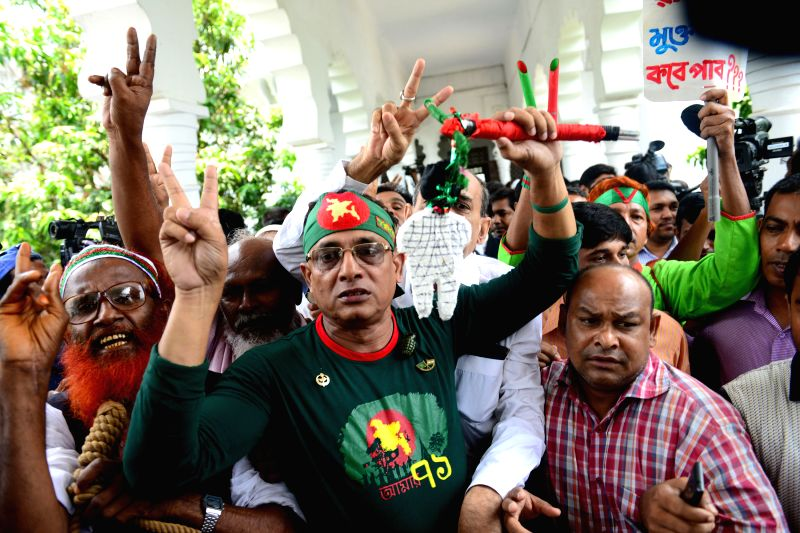 DHAKA, May 5, 2016 - Bangladeshi activists show the victory sign after a verdict announcement in Dhaka, Bangladesh, May 5, 2016. Nizami, the chief of Bangladesh's largest Islamist political party saw ...
